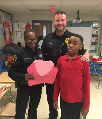 Mrs. Sloan's class shows love to district police.