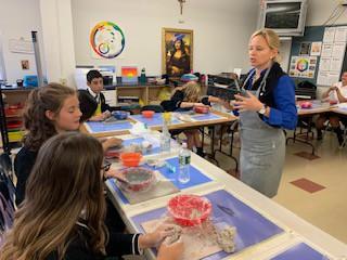 Mrs. Stam's clay class learn a creative technique.