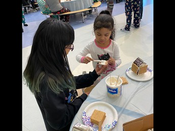 Kindergarten and 5th Grade Continue the Gingerbread House Making Tradition!
