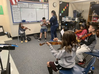 Violinists with Mrs. Graziano