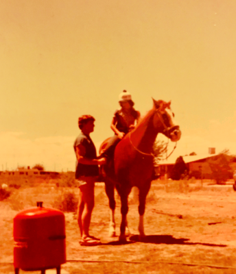 With my brother riding a horse