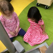 Preprimary students considering how to cover the feet.