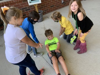 students helping another student for World Kindness Day