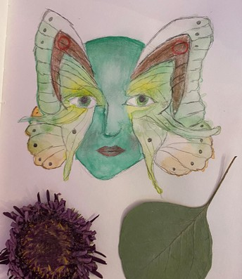 Drawing of fairy head with flowers and leaves
