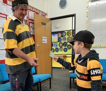 Lukas Shotter giving Mr Mac his Hip Hop donation!