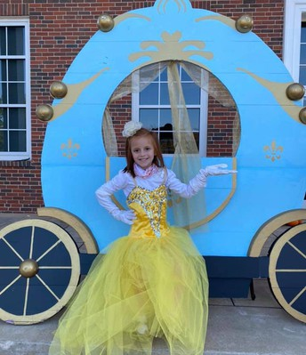 student in ball gown in front of carriage