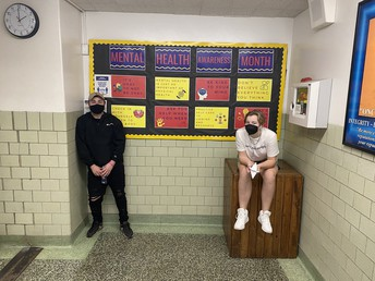 Students in front of bulletin board
