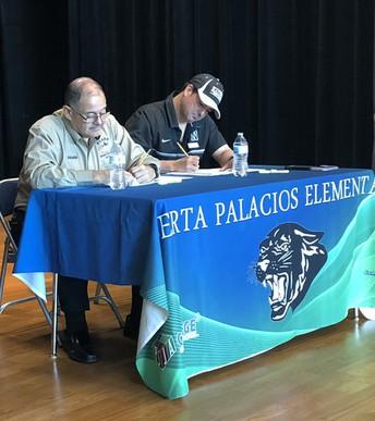 Mr. Palacios and Mr. Cantu selecting the Vocabulary Parade winners.