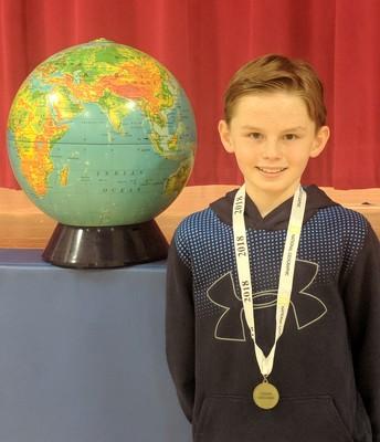 Memorial Geography Bee winner, 6th grader John Wamaster