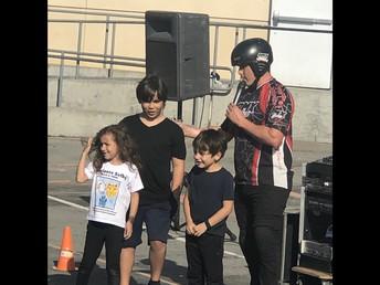 Student volunteers speaking with BMX performer