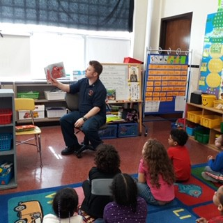 Captain Meyer reads to Miss Nassi's class