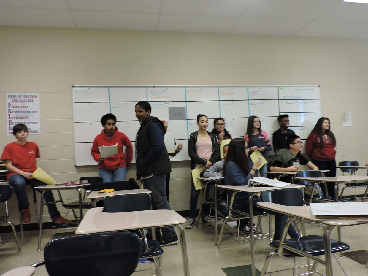Students Standing in Front of Class
