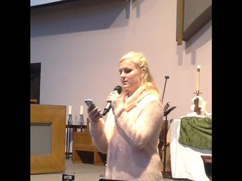 Junior Kayla Purdom reads a Scripture passage for worship at First Lewisville United Methodist Church's Wesley Sunday.