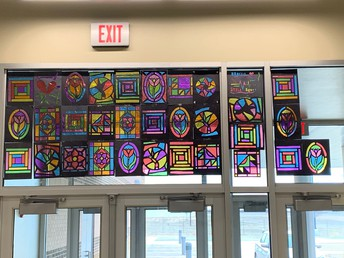 Art Students Brighten up the Windows at the Junior High!