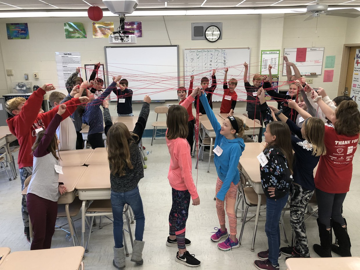 "Fifth grade students in Kristin Burt's class enjoy a hands-on activity wherein they built a life-sized ""food web""."