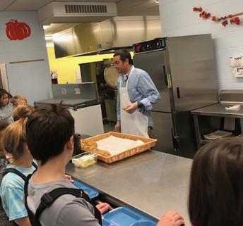 Mr. Arigo serving Thanksgiving lunch