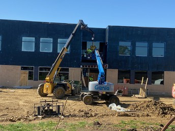 Some larger windows being put in an entryway
