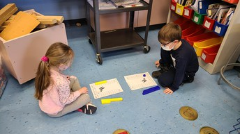 Math workstations and measuring with cubes.