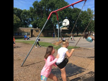 Student Leaders Helping Kindergarten students on the Playground