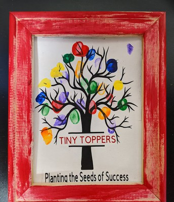 Planting the Seeds of Success framed thumbprint tree - a gift from Tiny Toppers Preschool students to Chardon Schools Board members for School Board Recognition month.