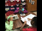 Students Reading Danny Dollar and writing what they learned from the chapter