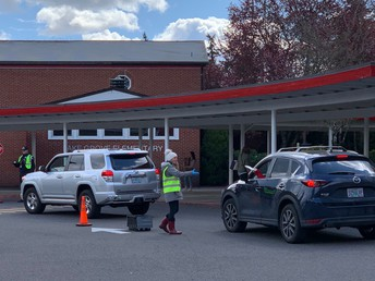 photo of device pick up at Lake Grove Elementary