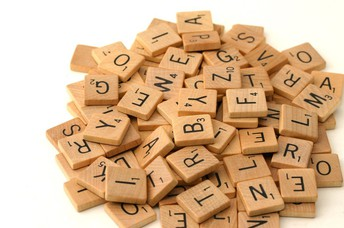 Scrabble pieces in a pile.