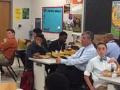 Mr. Plunkett (CZ Leader) listens in...