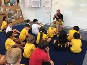 Coach Day talks with the class about water safety