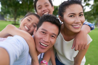 Image of a family smiling