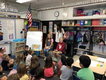 Miss Loch's former students reading to current Second Graders!