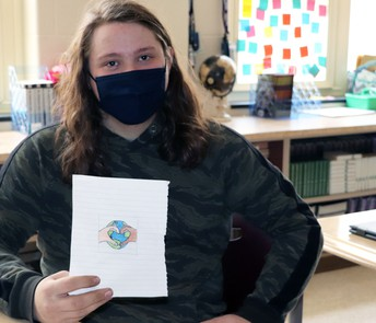 The winner of the PAWSitive Vibes button design contest for 2021 is James Walters, a senior at MCHS. Walters has been drawing as a hobby for about four years and says that he enjoys art because it calms him. He came up with his button design to promote equality, love, and kindness in the world.