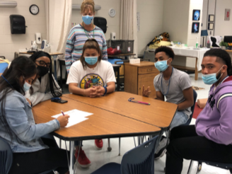 Healthcare instructor, Ms. Entrekin, and her students completing an activity for the Getting Along with Others Work Ready session.
