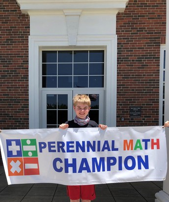 student Ford Rotenberry holding sign that reads Perennial Math Champion