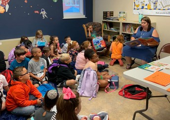 Mrs. Galloway reads with students each morning.