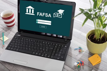 Laptop with FAFSA written on the screen.
