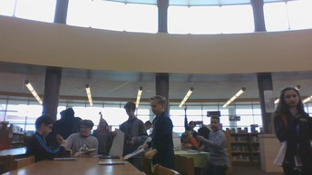 Working in the library media center.