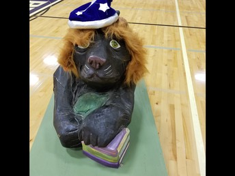 Penny donned a lion's mane and wizard hat in honor of our new students coming from Lincoln and Wickham.