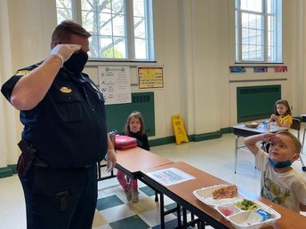 Chief Clark getting a salute from his new Kindergarten friend.