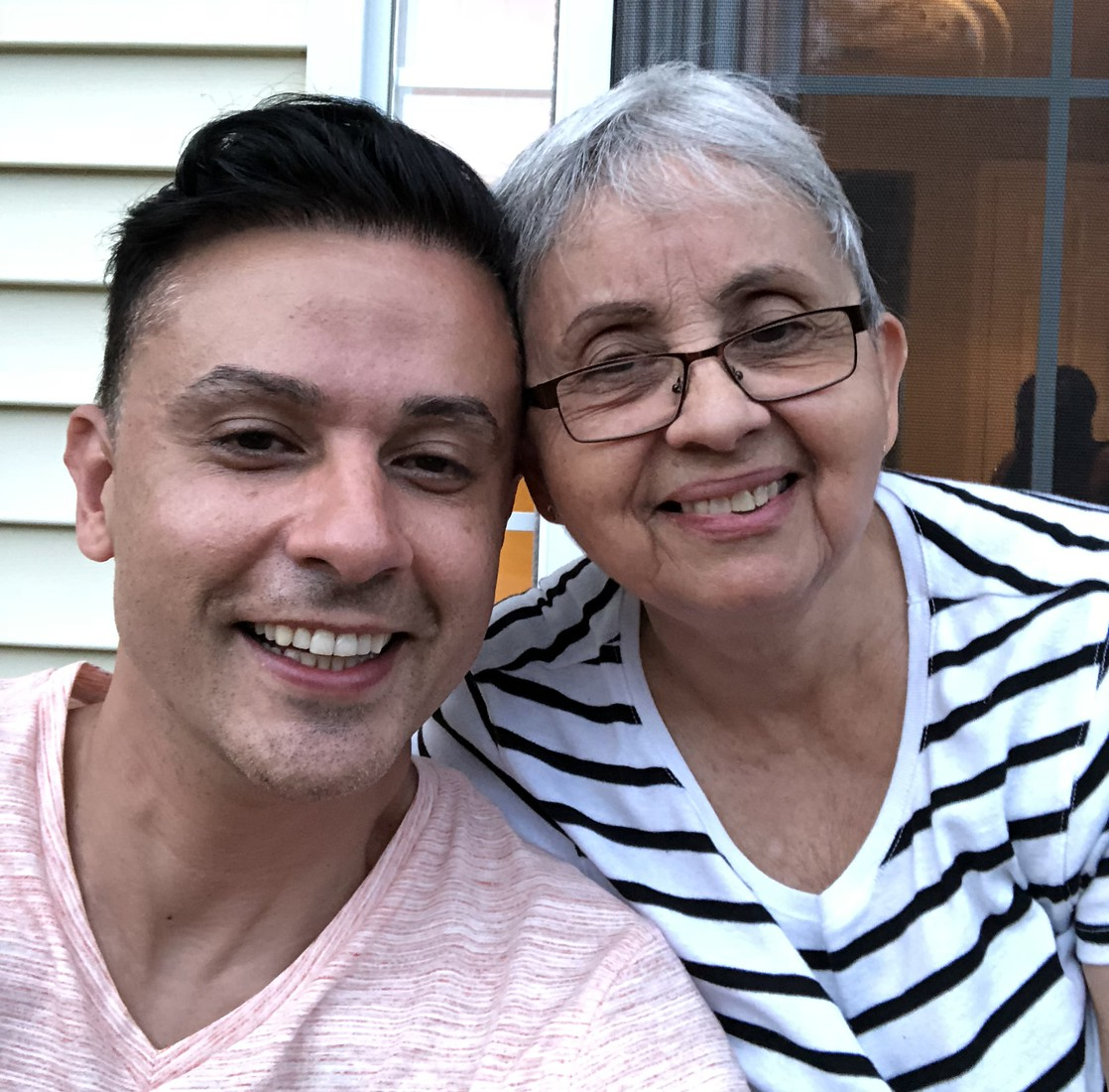 Photo of Dr. V with his mother in honor of Hispanic Heritage Month.