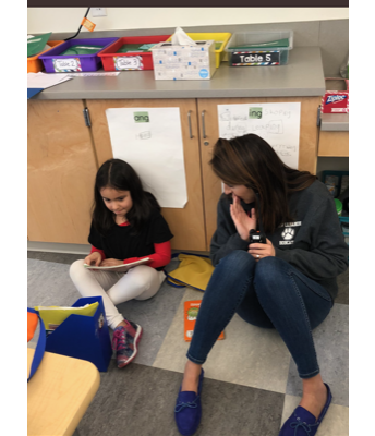 Ms. B reads with a 1st grader