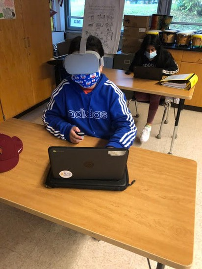 A student at Western Middle School wears Virtual Reality goggles funded by the Greenwich Alliance for Education's Reaching Out Grants.