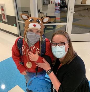 teacher with student in reindeer hat