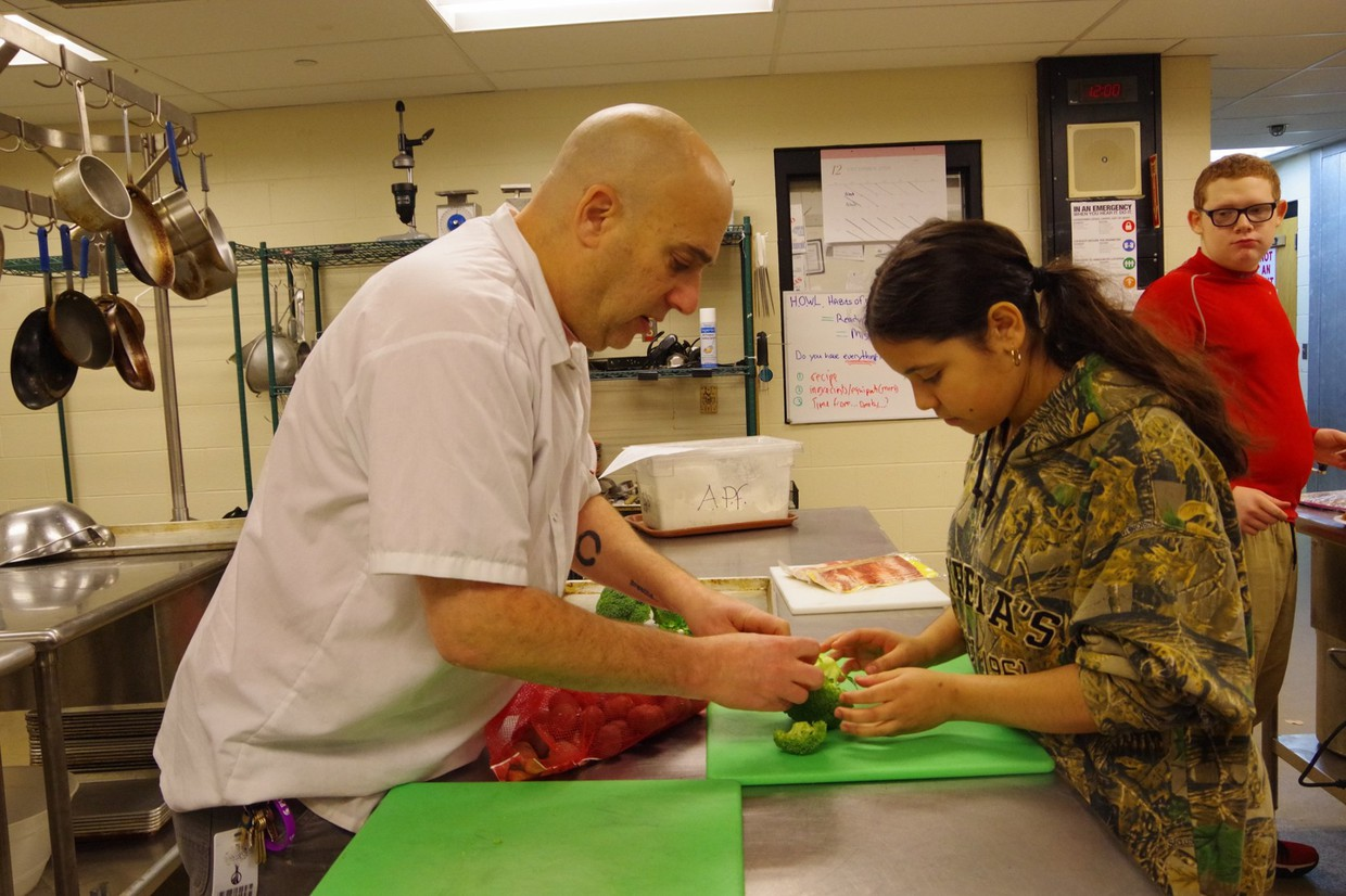 Chef K demonstrating with Dean Campus student