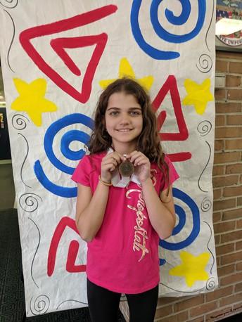 Maya Wins Bronze Medal