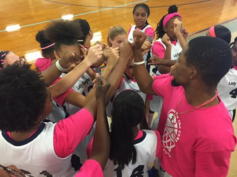 Coach K inspiring his girls at the Pink Out game.
