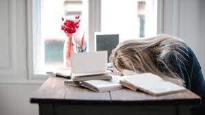 girls with head down on desk
