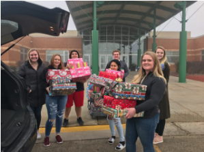 DECA Students Delivering Santa in a Box