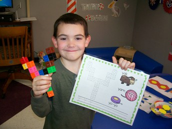 Brantley built the Letter Y using snap cubes.