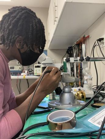 Electronics student, Owen Christian, working as a Junior Lab Technician.